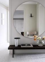 Oglinda rotunda cu rama argintie